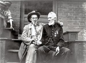 White Men who are extinct. These Civil War veterans in a gesture of reconciliation.